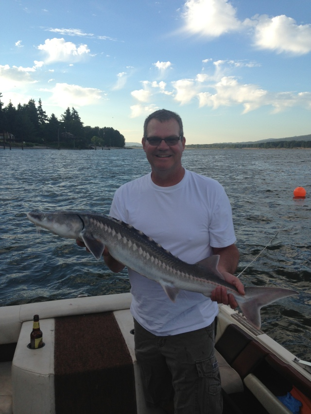Even got Darrin in the game!  His first sturgeon as well